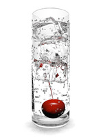 Glass and ice cubes, liquid and a cherry
