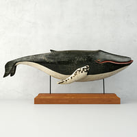 carved painted wooden humpback whale model