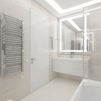The cozy bathroom with illuminated mirror