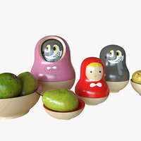 matryoshka doll and bowls of pears