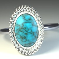 Ring with a blue stone