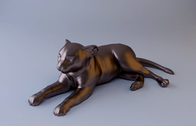 maya lion cub sculpture