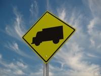 maya truck crossing street sign