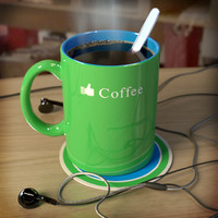 Green ceramic mug of coffee