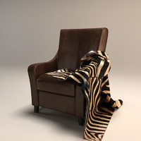 leather armchair with a blanket