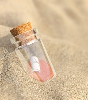 Realistic bottle in the sands