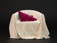 cloth armchair with pillow
