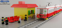 lego train with station and character