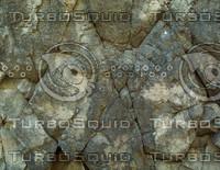 cracked mottled rock wall.jpg