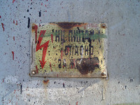 grunge high-voltage sign