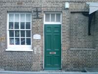 building front green doors