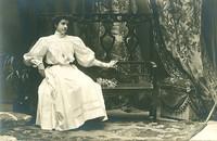 Old postcard woman sit