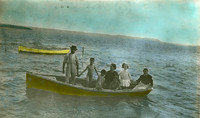 Old postcard family in a boat