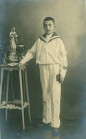 Old postcard: boy with comunion suite