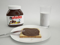 Nutella with slice of bread and glass of milk