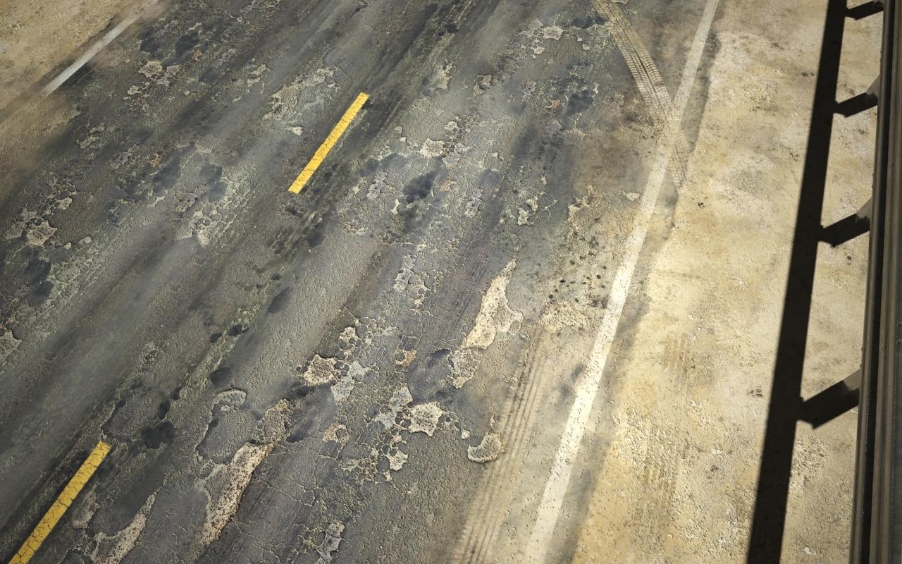 damaged asphalt road max