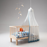 crib with cuddly toy and mobile
