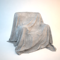 Armchair covered with sheet