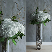 White hydrangeas in tall vase with willow branches