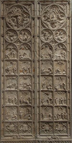 door with saints
