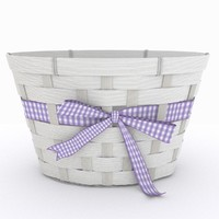 White wicker basket with gingham ribbon and bow