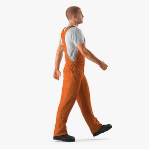 max builder wearing orange coveralls