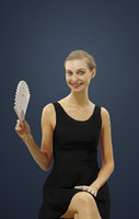 Andrea Smart Casual Caucasian Female Sitting While Waving a fan