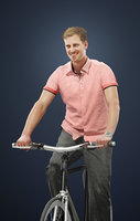 Michael A Caucasian Male Wearing A Pink Short-Sleeved Shirt While Riding His Bicycle