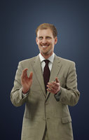 Michael A Caucasian Male In Business Attire Standing While Clapping Hands
