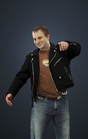 Vojtak Casual Caucasian Male In Black Leather Jacket And Pointing