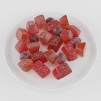 Red, orange and cherry marmalade gumdrops on a ceramic plate