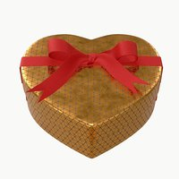 heart shaped box with ribbon tied round with bow