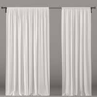 Wide white tulle curtains.