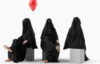 Arabic woman with balloon sitting in traditional outift
