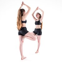 Young woman doing yoga routine 54