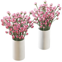 Bouquet of small pink shrub roses in a white vase 2