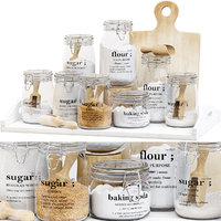 Set of glass jars for the kitchen with sugar and flour