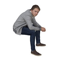 Boy in grey sweater sitting