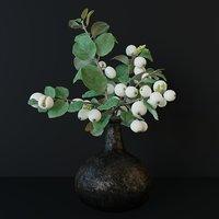 Snowberry branch in vase