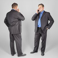 Man in suit talking on the phone 159